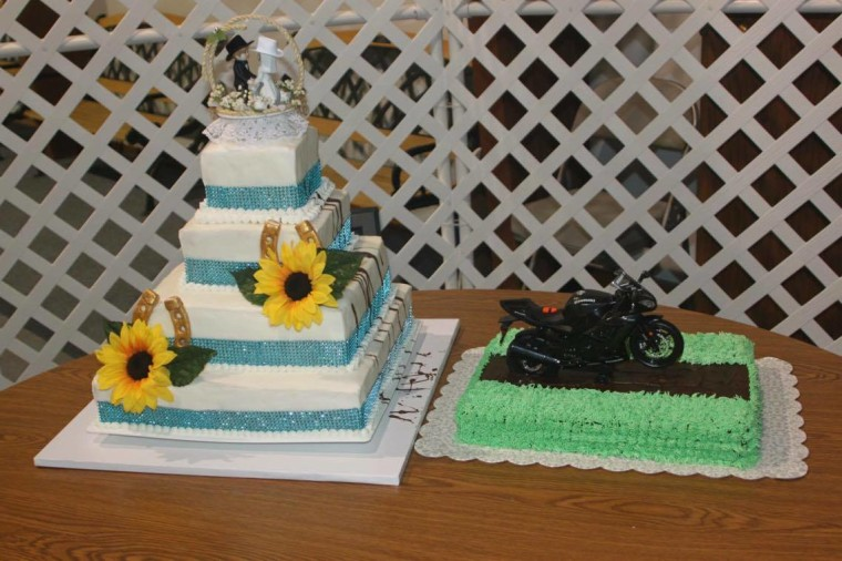 Two of Lori's specially-decorated cakes -- including her youngest daughter's wedding cake.
