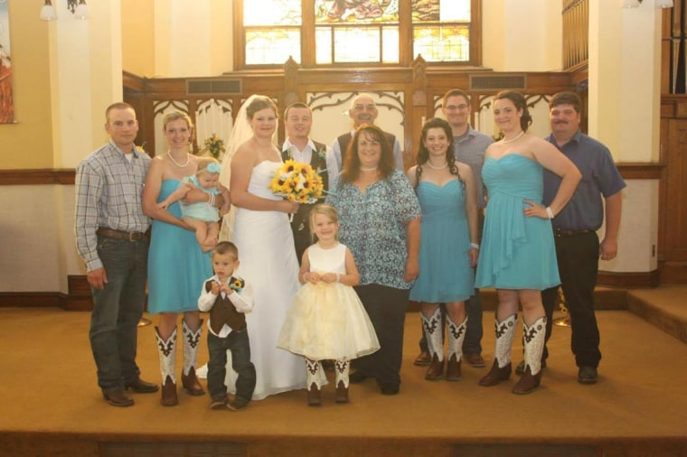 Lori, her husband Ron, and their four daughters at the wedding of their youngest daughter.
