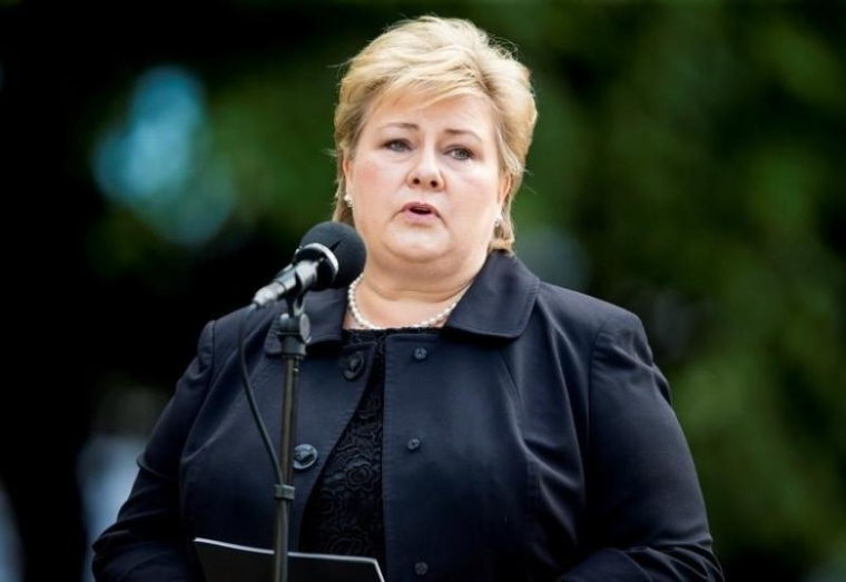 Norway's Prime Minister Erna Solberg speaks during a wreath laying ceremony outside a government building on the fifth anniversary of the attacks by mass killer Anders Behring Breivik in Oslo