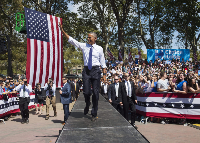 Image: Obama arrives at a Hillary Clinton rally