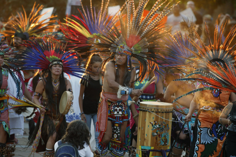 Native Americans head to a rally at the State Capitol in Denver, Colo., Thursday, Sept. 8, 2016, to protest in solidarity with members of the Standing Rock Sioux tribe in North Dakota over the construction of the Dakota Access oil pipeline. The tribe argues that the pipeline, which crosses four states to move oil from North Dakota to Illinois, threatens water supplies and has already disrupted sacred sites. (AP Photo/David Zalubowski)