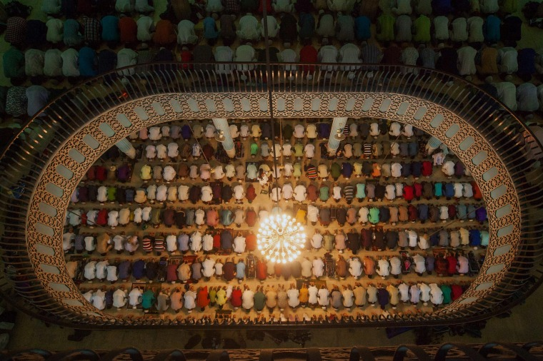 Image: Bangladeshi Muslims attend Eid al-Adha prayers at Baitul Mukarrom National Mosque
