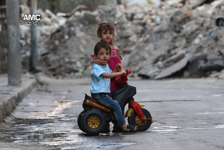 Children play in the street amid the bombed-out ruins of eastern Aleppo, Syria.