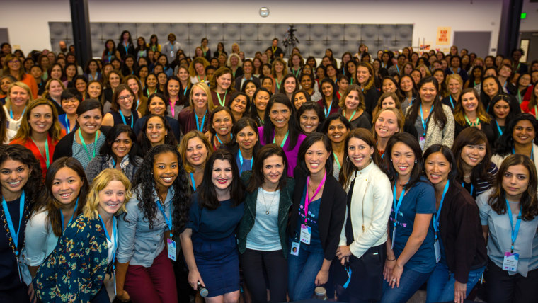 Facebook COO Sheryl Sandberg is at the center of a group photo at Facebook's Women in Product Conference in Menlo Park, California on September 13, 2016.  Conference co-founders Fidji Simo and Deb Liu are to her left and right.
