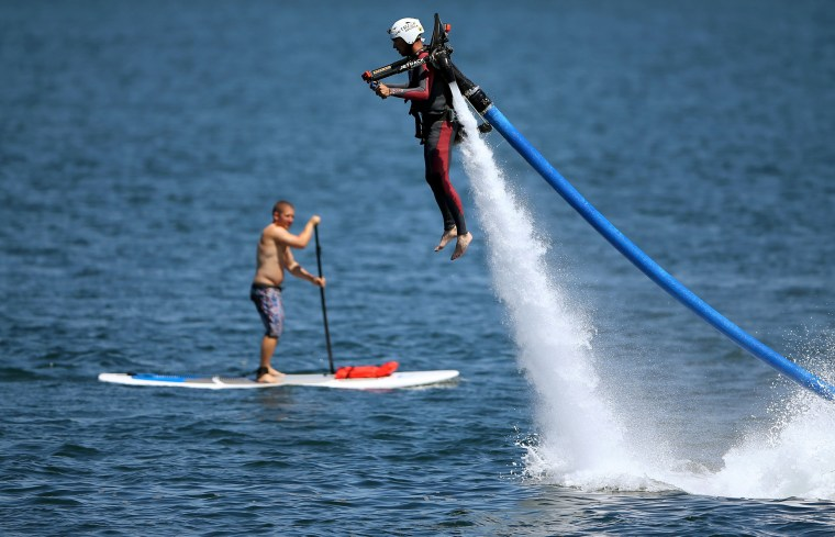 Image: U.S. military veteran Joshua Alves shoots out of the ocean on a water jetboard as part of an event by Warrior Passion and Jetpack America in San Diego