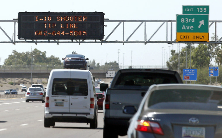 A sign advises motorists of a shooter tip line above Interstate 10 in Phoenix on Sept. 11, 2015, after a series of random shootings on Phoenix freeways.
