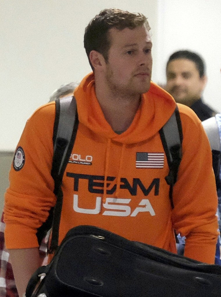 Image: U.S. Swimmers Jack Conger and Gunnar Bentz arrive on an overnight flight from Brazil to Miami in Miami
