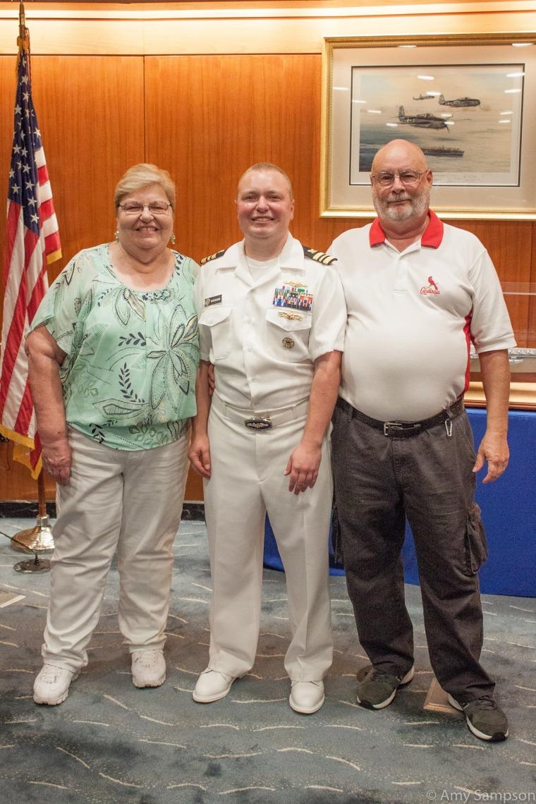 Navy Lt. Cdr. Blake Dremann (middle) and his parents, Rev. Dr. Dave Dremann and Mrs. Diane Dremann