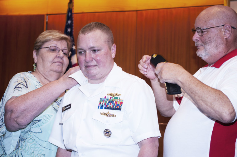 Navy Lt. Cdr. Blake Dremann with his parents Rev. Dr. Dave Dremann and Mrs. Diane Dremann