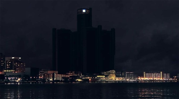 GM's Renaissance Center headquarters in Detroit, Michigan, shown at night.