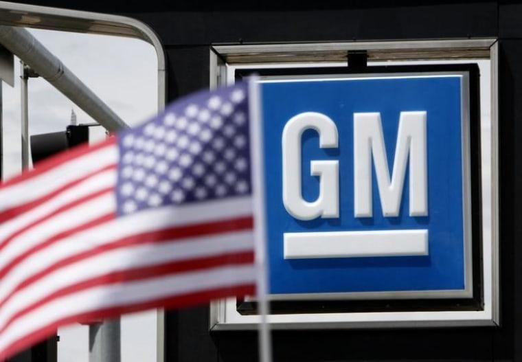 The U.S. flag flies at the Burt GM auto dealer in Denver