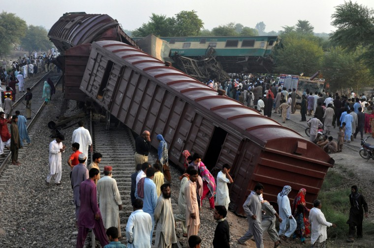 Image: Locals gather at the scene where two trains collided near Multan
