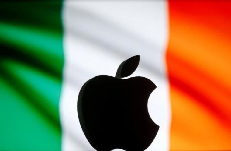 A 3D printed Apple logo is seen in front of a displayed Irish flag in this illustration