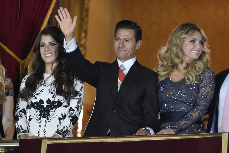 President Enrique Pena Nieto, accompanied by his wife Angelica Rivera and daughter Paulina Pena, at Mexico's Independence Day celebrations.