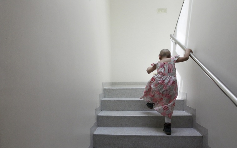 Image: Alexandra Munoz climbs stairs in the cancer ward of the Luis Calvo Mackenna Hospital in Santiago
