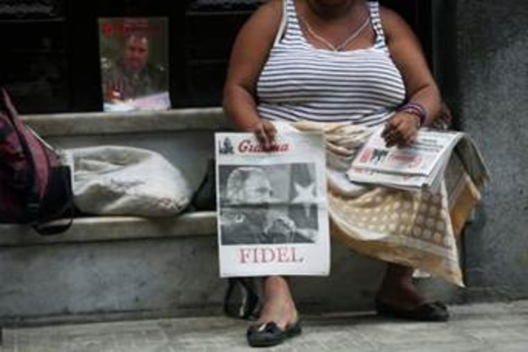 A woman sells copies of Granma, the official newspaper of the Cuban Communist Party (PCC), featuring a front page picture of former Cuban President Fidel Castro, in Havana on Sept. 14.