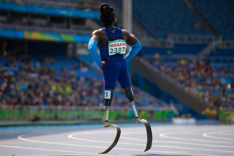 Image: Regas Woods, of the United States, looks on after competing in round 1 of the men's 100-meter T42 athletics event