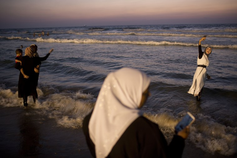 Image: Palestinians spend the day on the beach during the Muslim Eid al-Adha holiday