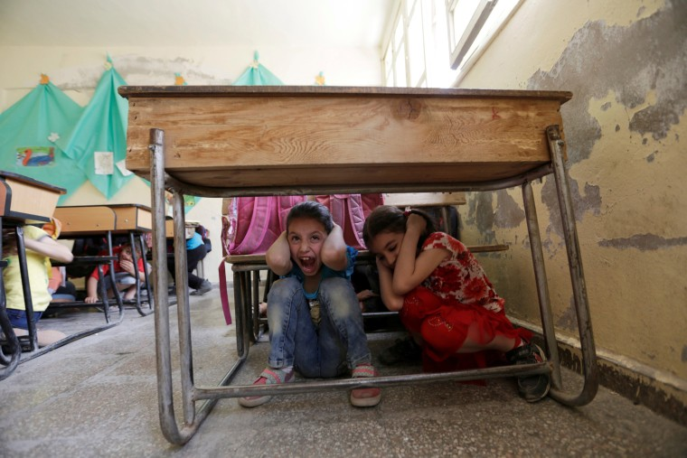 Image: Children attend a war safety awareness class conducted by civil defence members, in the rebel-controlled area of Maaret al-Numan town in Idlib province