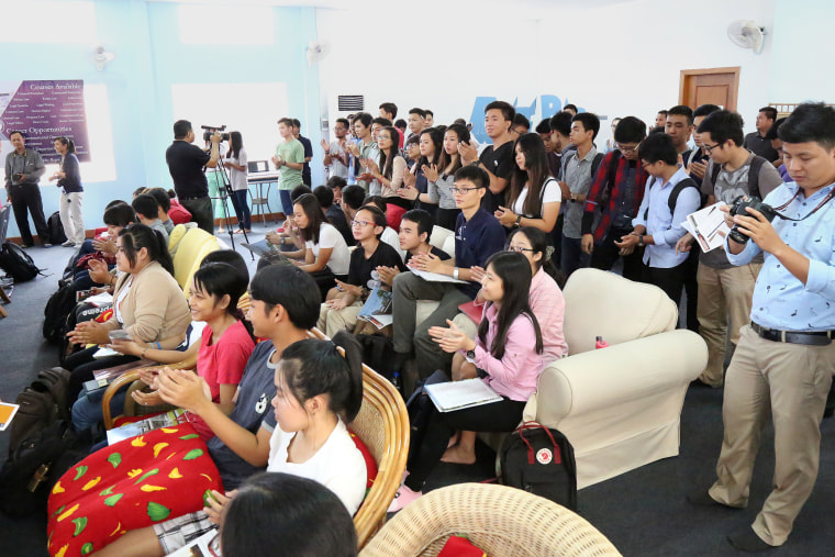 Students from the American University of Phnom Penh applaud the school's dual degree program agreement with the University of Arizona.