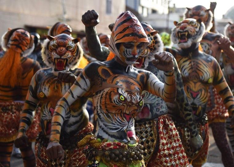 Image: TOPSHOT-INDIA-FESTIVAL-PULIKALI