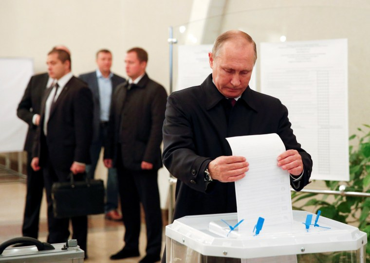 Image: Russian President Putin visits polling station during parliamentary election in Moscow