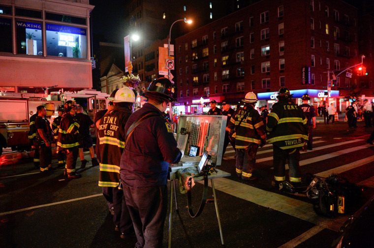 Image: New York City police and firefighters stand near the site of an explosion in the Chelsea neighborhood of Manhattan, New York
