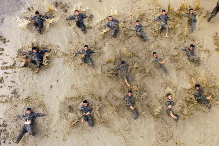 Image: Paramilitary policemen take part in a drill in Baise