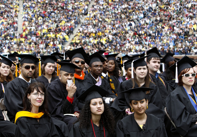 Image: Graduating students listen to U.S. President Obama speak during commencement at the University of Michigan