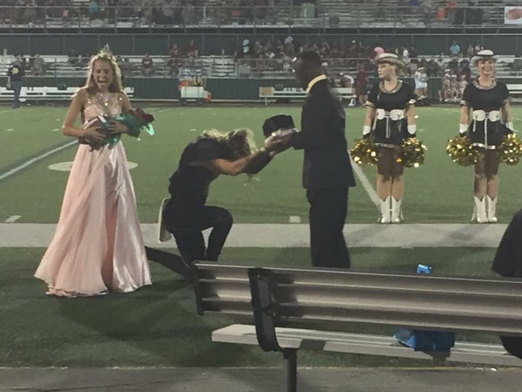 Image: Fossil Ridge senior Max Akin turns over his crown to classmate K.L. Norwood.