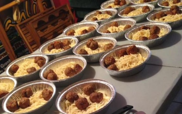 Lauren Puryear preps spaghetti and meatballs to give away