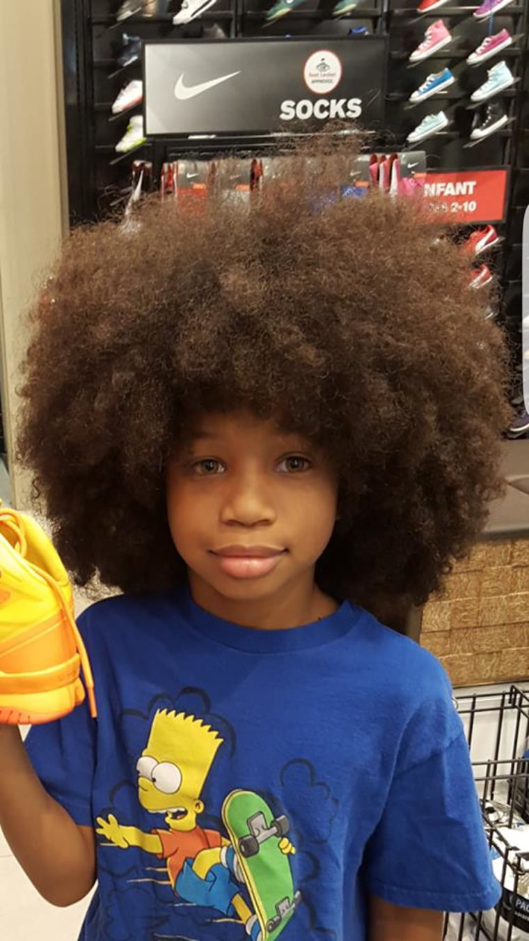 Boy grows hair for two years to help girl with cancer