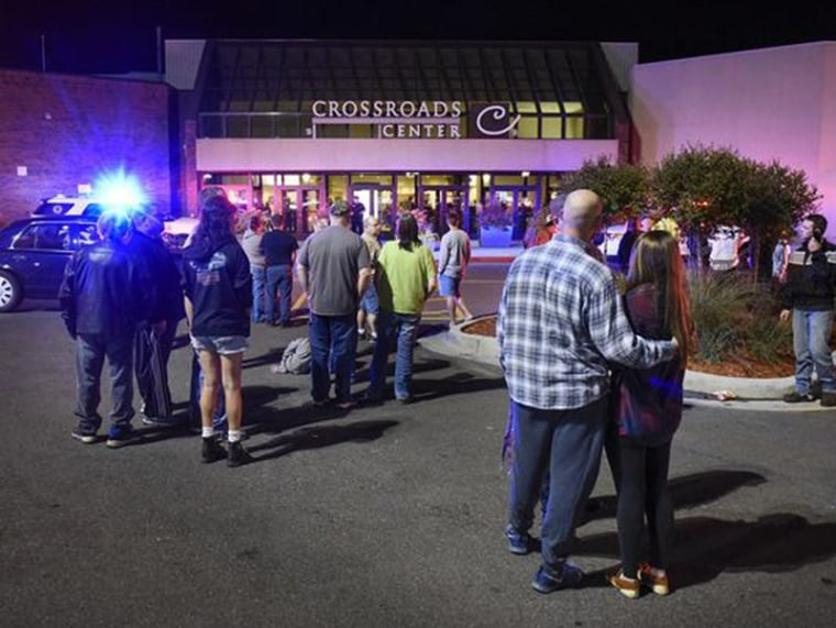 Image: People stand near the entrance on the north side of Crossroads Center mall
