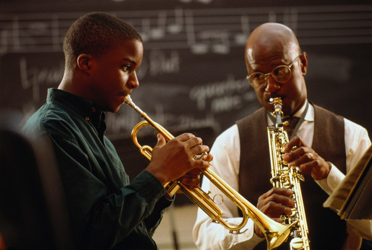 Image: Music teacher performing with student
