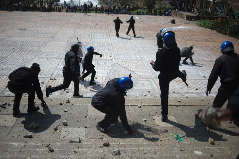Image: Security guards from the University of the Witwatersrand pelt students with stones