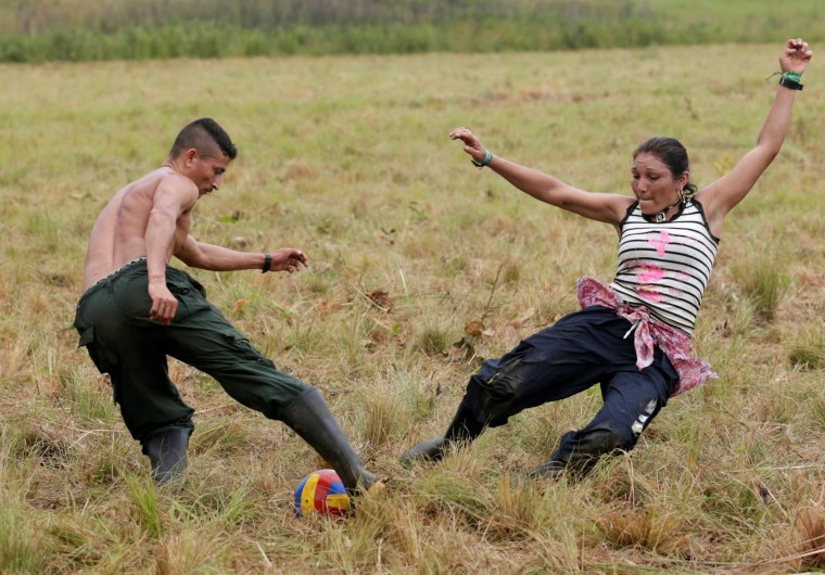Image: Fighters from Revolutionary Armed Forces of Colombia (FARC) play soccer at a camp where they prepare to ratify a peace deal with the government, near El Diamante in Yari Plains, Colombia