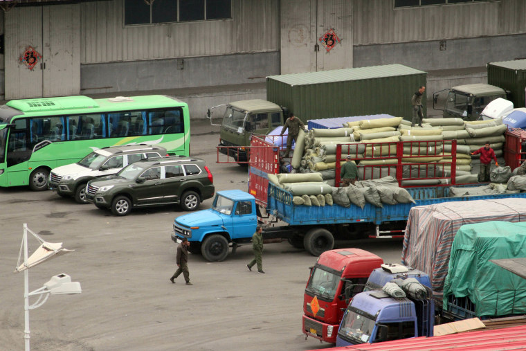 Image: Cargo trucks and other vehicles wait at a border checkpoint to cross into North Korea in Dandong