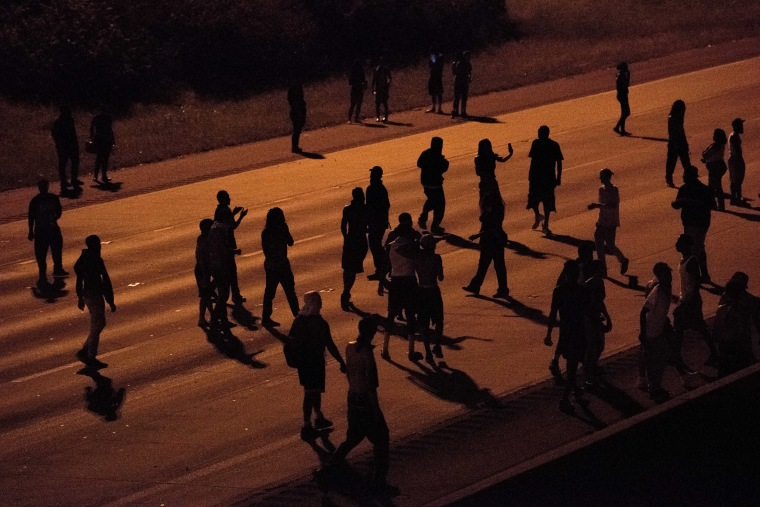 Image: Protesters block traffic on the I-85 during protests.