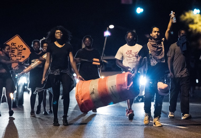 Image: Protesters march down W.T. Harris Blvd