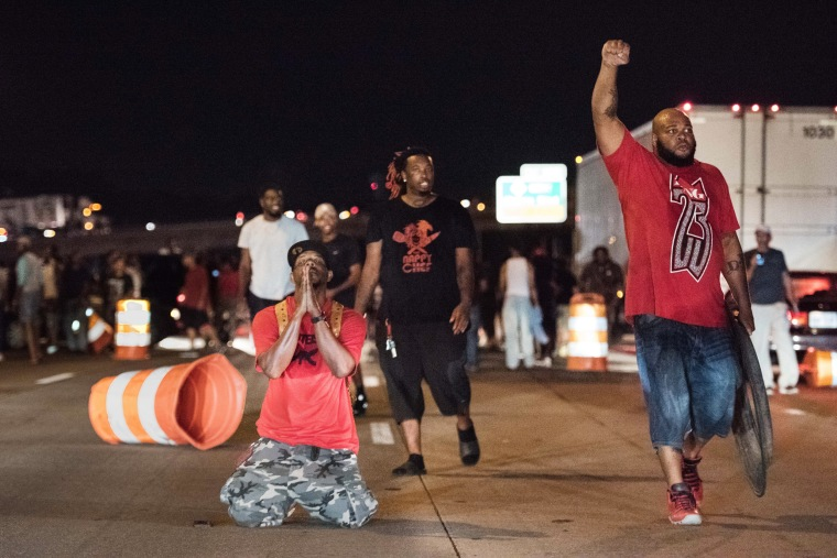 Image: People block traffic on I-85 during protests