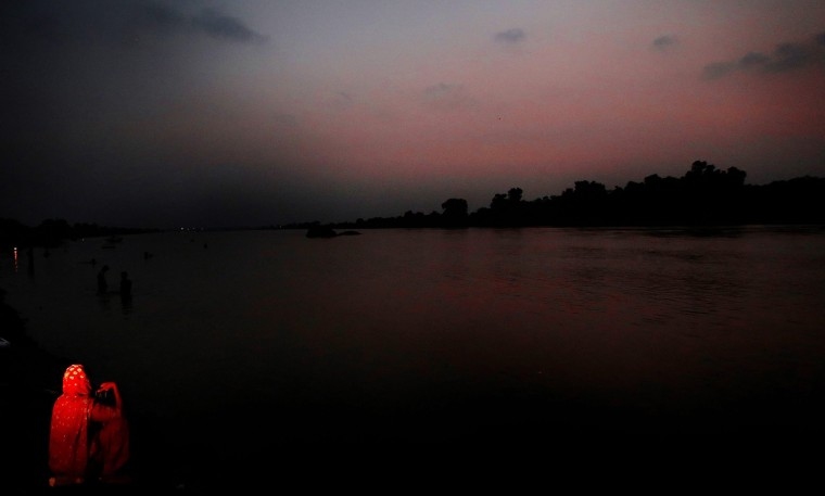 Image: A woman sits at the bank of river Ravi as the sunsets in Lahore
