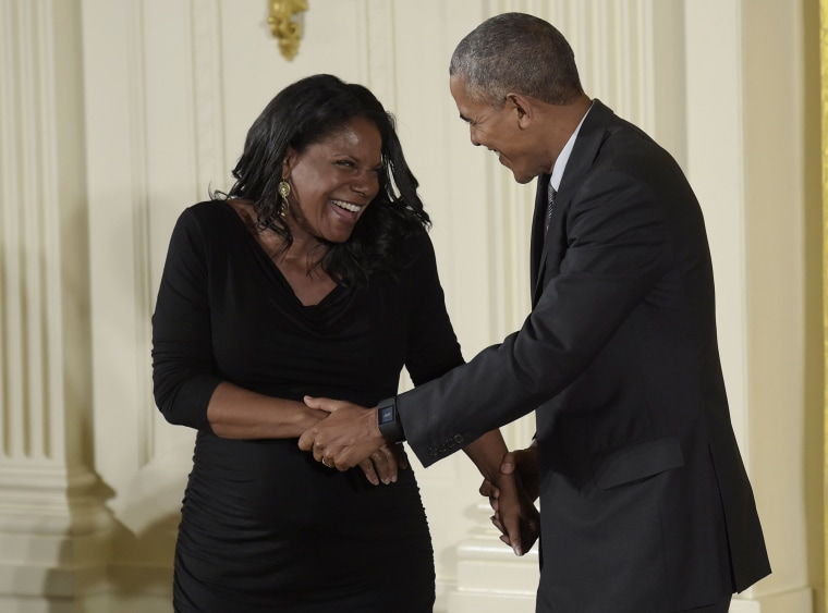 Image: President Barack Obama shares a laugh with actress and singer Audra McDonald