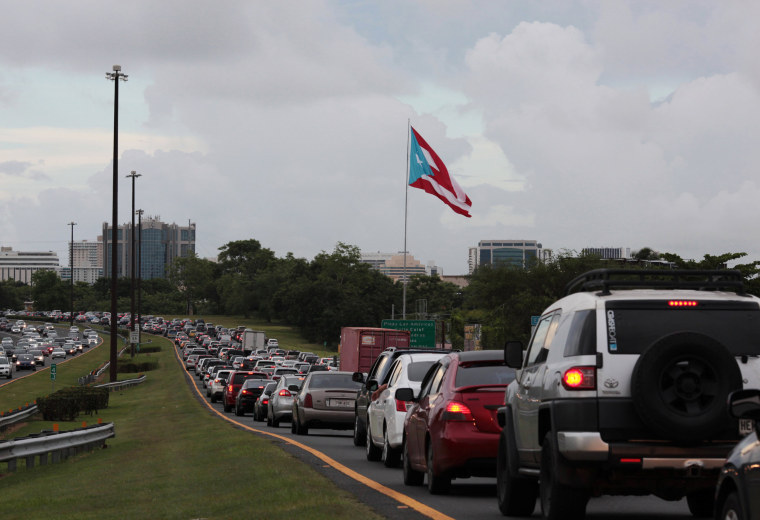 Image: Cars are pictured in a traffic jam as traffic lights were down during a power outage that affected several areas in the country, in San Juan