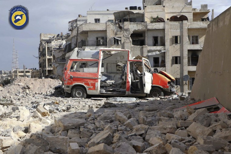 Image: A photo provided by the Syrian Civil Defense group, known as the White Helmets, shows what it says is a destroyed ambulance after Friday morning's air strikes.