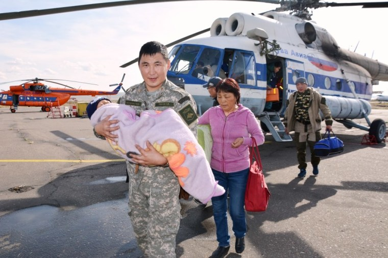 Image: Tserin Dopchut is carried from a helicopter