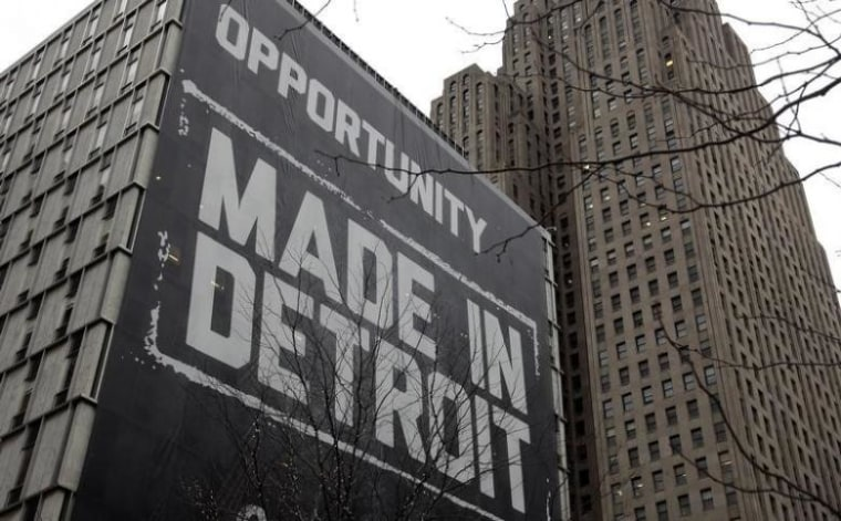 """A large \""""Opportunity Made In Detroit\"""" banner is seen on the side of one of the buildings owned by Quicken Loans founder Gilbert in downtown Detroit"""