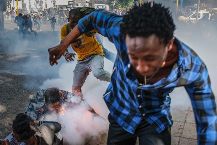 Image: Students are injured by a police grenade during a protest in Johannesburg