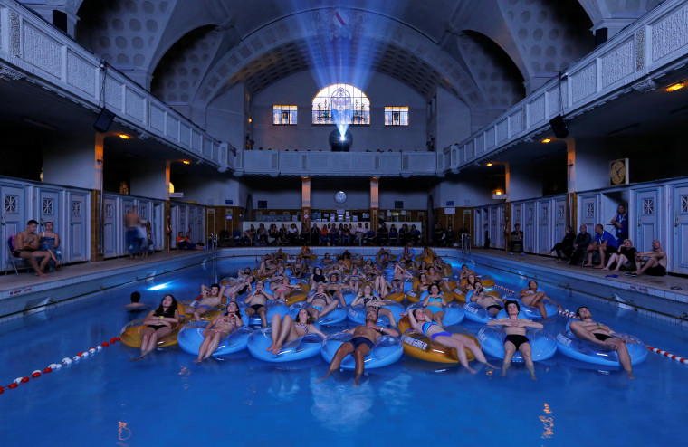 "Image: People attend the screening of the film ""Jaws"" by director Steven Spielberg, screened at Strasbourg public baths during the European Fantastic Film Festival, in Strasbourg"