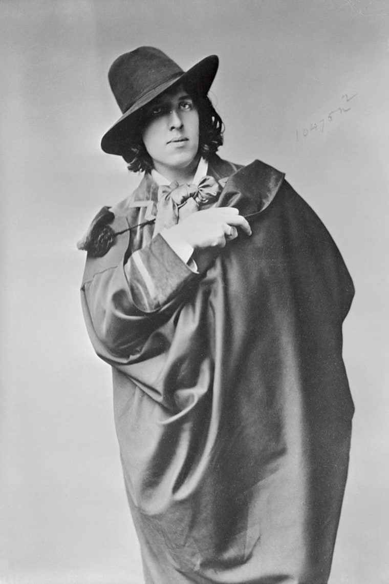 Oscar Wilde in Cape and Hat