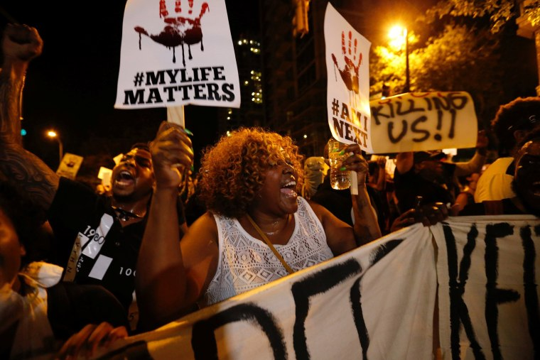 Image: A woman yells during a protest against the police shooting of Keith Scott in Charlotte